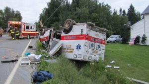 EMT driver flips ambulance after falling asleep at wheel, police say